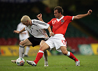 Photo: Rich Eaton.<br /> <br /> Wales v Germany. UEFA European Championships Qualifying. 08/09/2007. Germany's Bastian Schweinsteiger (L) is tackled by Wales Carl Fletcher.