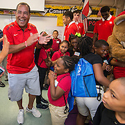 University of Houston basketball coach Kelvin Sampson cheers for students during the Read for the NCAA Final Four kick-off at Blackshear Elementary School, September 24, 2015.