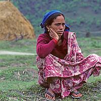 A Chettri caste farm woman relaxes in Nepal's Marsyandi Valley.