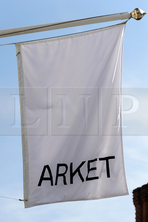 © Licensed to London News Pictures. 25/08/2017. London, UK. Exterior flag sign for the new opening of H&M group's first ARKET flagship store in Regent Street is situated next to Weekend store and a H&M store. ARKET has called itself a modern day market seeing not only clothes, but homeware as well as a small cafe space. Photo credit: Ray Tang/LNP