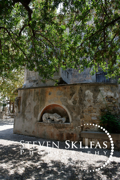 Kos Town.  View of an ancient architectural fragment or sculpture embedded on an external wall of the 18th-century Mosque of Gazi Hassan Pasha. Kos is part of the Dodecanese island group and birthplace of the ancient physician and father of medicine, Hippocrates.