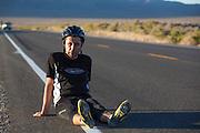 Ben Goodall komt bij op het asfalt op de de vierde racedag van de WHPSC. In de buurt van Battle Mountain, Nevada, strijden van 10 tot en met 15 september 2012 verschillende teams om het wereldrecord fietsen tijdens de World Human Powered Speed Challenge. Het huidige record is 133 km/h.<br /> <br /> Ben Goodall recovering on the asphalt after his run on the fourth day of the WHPSC. Near Battle Mountain, Nevada, several teams are trying to set a new world record cycling at the World Human Powered Vehicle Speed Challenge from Sept. 10th till Sept. 15th. The current record is 133 km/h.