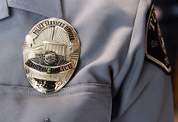 May 2, 2019 - Tustin, California, U.S. - Tustin Police Service Officer Denise Avila shows the new badge design for sworn officers in the Tustin Police Department on Thursday, May 2, 2019. (Credit Image: © Paul Bersebach/SCNG via ZUMA Wire)