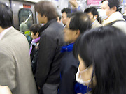 rush hour commuters inside a train Tokyo Japan