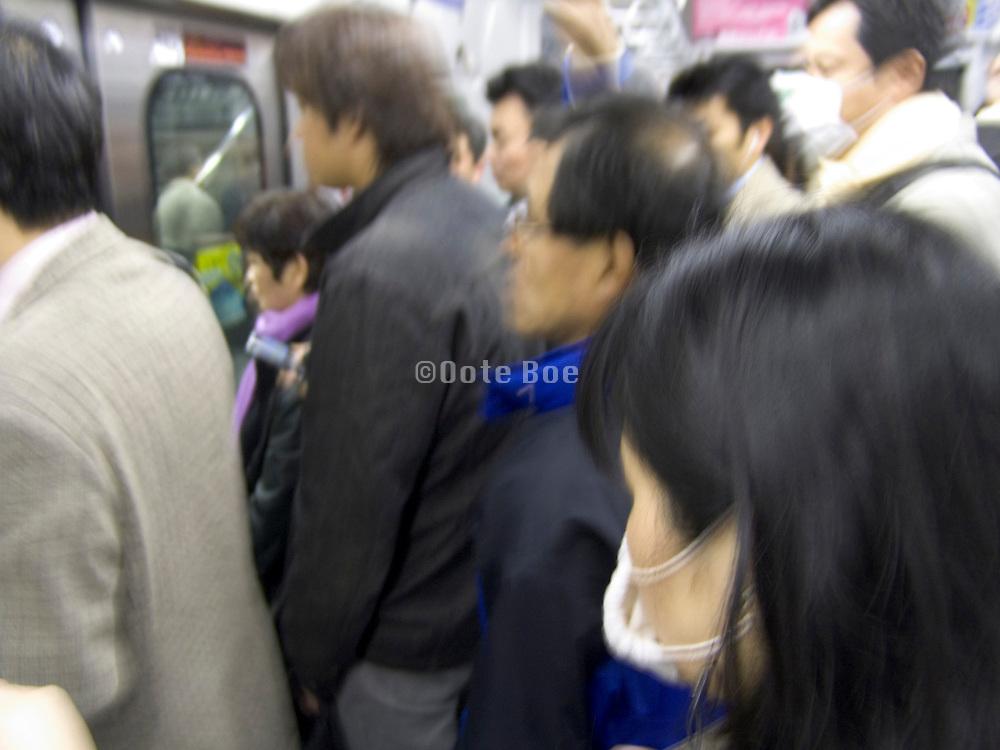 rush hour commuters inside a train Tokyo Japan