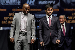 LOS ANGELES, CA - MAR 10 Floyd Mayweather and Manny Pacquiao pose for the media after the Mayweather vs Pacquiao press conference at the Nokia Theater in Los Angeles, California USA to promote their upcoming bout at the MGM Grand in Las Vegas, NV May 2, 2015. This is the ony presser. 2015 Feb 9. Byline, credit, TV usage, web usage or linkback must read SILVEXPHOTO.COM. Failure to byline correctly will incur double the agreed fee. Tel: +1 714 504 6870.