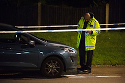 © Licensed to London News Pictures. 13/04/2019.<br /> Orpington, UK. The car that struck the child being looked at by a police officer. A child is in a critical condition in hospital after being hit by a blue car in Orpington, South East London tonight. Traffic police are on scene with cordons in place on Court Road A224. Photo credit: Grant Falvey/LNP
