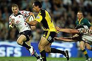 Hosea Gear beats Luke Burgess and Drew Mitchell<br /> Super 14 rugby union match, Waratahs vs Hurricanes, Sydney, Australia. <br /> Saturday 14 May 2010. Photo: Paul Seiser/PHOTOSPORT