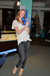 OLIVIA INGE at the official opening of the 2014 Tiffany & Co.Christmas Shop on Bond Street, London on 16th November 2014.