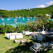 The cemetery of Gallows Point is in the foreground with the natural harbor of Cruz Bay in the background on St. John in the US Virgin Islands