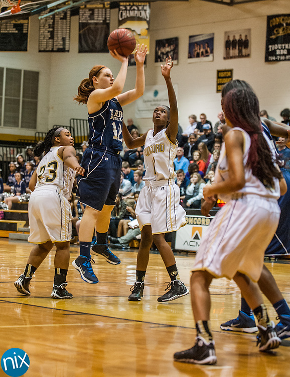 Hickory Ridge's Mary K. Wallace takes a shot against Concord Friday night at Concord High School. Hickory Ridge won the game 55-35.