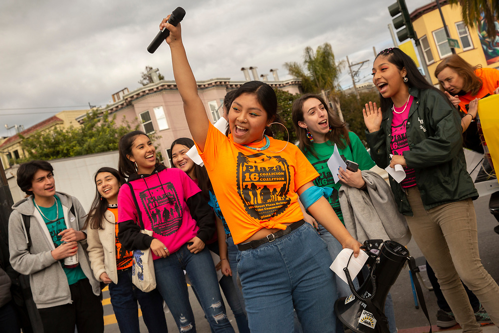 """Inkza Angeles Bautista of PODER leads a chant at a rally against the housing proposal often referred by critics as the """"Monster in the Mission,"""" on Thursday, Feb. 7, 2019, in San Francisco, Calif. A community meeting was held at Mission High School to hear public reaction on the housing project for 1979 Mission Street."""