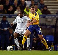 Photo. Jed Wee.<br /> Bolton Wanderers v Southampton, FA Barclaycard Premiership, Reebok Stadium, Bolton. 08/11/03.<br /> Bolton's Jay Jay Okocha (L) holds off Southampton's Paul Telfer.