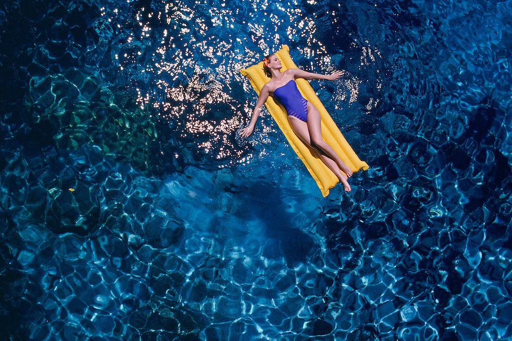 Lady floating on raft Negril, Jamaica, Ten SIng Pen Resort