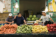 Yidzack and his sons on his vegetable stall at the Mahane Yahuda Market, Jerusalem, Israel