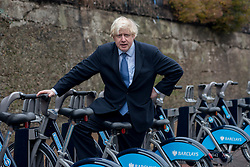 © Licensed to London News Pictures.13/12/2013. London, UK. Mayor of London, Boris Johnson poses for a photograph during the launch of the south west expansion of the Barclays Cycle Hire into Hammersmith & Fulham and Wandsworth.Photo credit : Peter Kollanyi/LNP