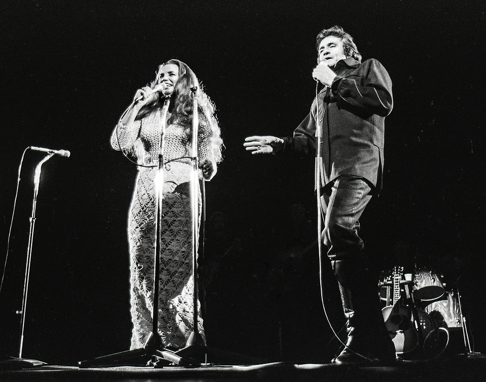 Johnny Cash performing in 1978 in Columbia, Missouri, with June Carter Cash and Carter Sisters.