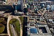 Nederland, Zuid-Holland, Den Haag, 20-03-2009; Prinsessegracht met Ministerie van Financien met atrium en binnentuin onder in beeld. Op het middenplan en van links naar rechts in het midden de Herengracht overgaand in de Fluwelen Burgwal, met Centraal Station, Hoftoren (ministerie OCW), Zurichtoren (huisvest onder andere kantoren van de OPTA en NMA) met daar achter de dubbele toren van Castalia (bijgenaamd de Haagse Tieten - ministerie VWS), geheel rechts de  ministeries van Justitie en Binnenlandze zaken en een stukje stadhuis. View on the Ministry of Finance in The Hague, the blue building (bottom). Behind it on the left, the Royal Academy of Arts. Top left the Central Station, next Ministry of Education, next the Twin Buildings called The Tits, residence of the Ministry of Health, Welfare and Sport . Swart collectie, luchtfoto (toeslag); Swart Collection, aerial photo (additional fee required); .foto Siebe Swart / photo Siebe Swart