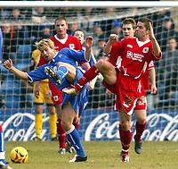 Photo: Chris Ratcliffe.<br />Gillingham v Bristol City. Coca Cola League 1. 26/12/2005.<br />Bradley Orr (R) of Bristol City tussles with Danny Spiller of Gillingham.