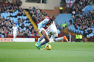Aston Villa's Leandro Bacuna battles with Swansea City's Pablo Hernandez during the Barclays Premier league, Aston Villa v Swansea city at Villa Park in Birmingham, England on Saturday 28th Dec 2013. <br /> pic by Jeff Thomas, Andrew Orchard sports photography.
