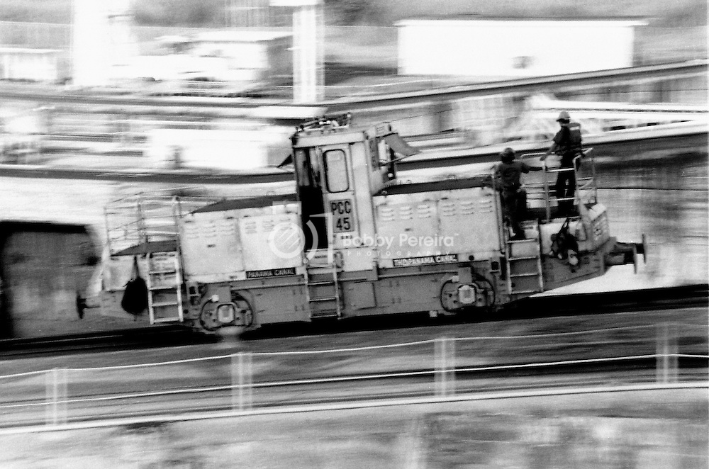 Panning of a Locomotive rushing to it's position at the Miraflores Locks in the Panama Canal.