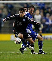 Photo: Steve Bond/Richard Lane Photography. Leicester City v Peterborough United. Coca-Cola Football League One. 20/12/2008. Chris Whelpdale (L) shields the ball from Steve Howard (R)