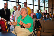 16 MAY 2011 - PHOENIX, AZ: TOBY STAHL, from Phoenix, AZ, shouts at Congressman Ben Quayle at a town hall meeting in Phoenix Monday. About 200 people attended Congressman Ben Quayle's (R-AZ) town hall meeting in the Anthem neighborhood of Phoenix, AZ, Monday. Quayle, son of former Vice President Dan Quayle, was elected in the Republican tide that captured the House of Representatives in Nov. 2010. Quayle tried to run under a Tea Party banner. Most of the people in the crowd were hostile to Quayle and the GOP budget proposal that would change medicare to a voucher system and Quayle was shouted down several times when he tried to support the budget.     Photo by Jack Kurtz