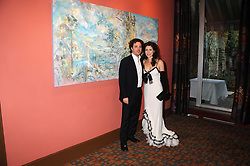 Artist SACHA NEWLEY and his wife ANGELA at a private view of work by Sacha Newley entitled 'Blessed Curse' in association with the Catto Gallery held at the Arts Club, Dover Street, London W1 on 2nd July 2008.<br /><br />NON EXCLUSIVE - WORLD RIGHTS