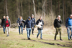 Group returning from successful first stage of Field cricket Gryllus campestris project with 6 pairs of crickets ready to be translocated, RSPB Farnham Heath Nature Reserve, Surrey, April