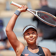 PARIS, FRANCE May 30. Naomi Osaka of Japan celebrates her victory after her match against Patricia Maria Tig of Romania in the first round of the Women's Singles competition on Court Philippe-Chatrier at the 2021 French Open Tennis Tournament at Roland Garros on May 30th 2021 in Paris, France. (Photo by Tim Clayton/Corbis via Getty Images)