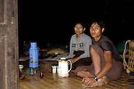 Myanmar/Burma. Taung you village in the Shan Mountains. Taung Yo people drinking tea at their home.