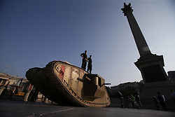 Members of the Royal Tank Regiment stand on a replica First World War Mark IV tank in London's Trafalgar Square marking the centenary of an armoured vehicle's first-ever deployment during the Battle of the Somme.