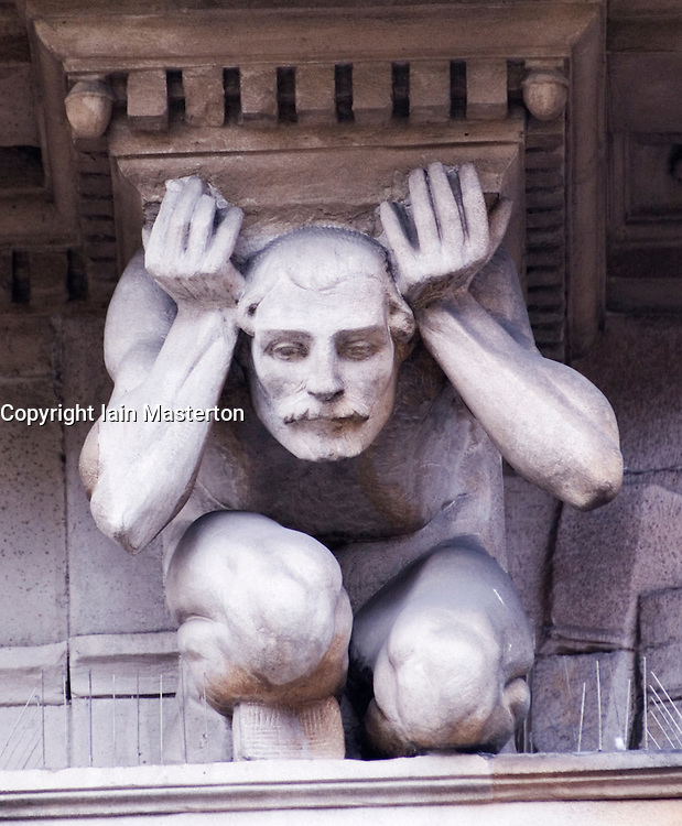 Detail of ornate stone statue on historic building in Merchant City district of Glasgow Scotland UK