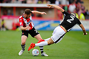 Jake Taylor (25) of Exeter City makes a tackle on Sean Long (2) of Lincoln City during the EFL Sky Bet League 2 match between Exeter City and Lincoln City at St James' Park, Exeter, England on 19 August 2017. Photo by Graham Hunt.