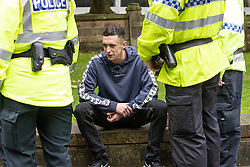 © Licensed to London News Pictures . 16/09/2018. Manchester, UK. Police detain a man who shouted anti-Semitic tropes at the demonstration . Thousands of people including the UK's Chief Rabbi and several Members of Parliament attend a demonstration against rising anti-Semitism in British politics and society , at Cathedral Gardens in Manchester City Centre . Photo credit : Joel Goodman/LNP