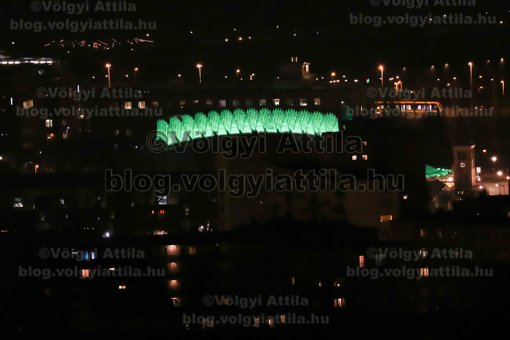 Spike sports hall is seen with green light decoration celebrating Saint Patrick's Day in central Budapest, Hungary on March 17, 2017. ATTILA VOLGYI