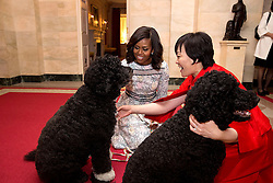 First Lady Michelle Obama and First Lady Akie Abe of Japan are greeted by Obama family pets Bo and Sunny in the Ground Floor Corridor of the White House, April 28, 2015. (Official White House Photo by Amanda Lucidon)<br /> <br /> This official White House photograph is being made available only for publication by news organizations and/or for personal use printing by the subject(s) of the photograph. The photograph may not be manipulated in any way and may not be used in commercial or political materials, advertisements, emails, products, promotions that in any way suggests approval or endorsement of the President, the First Family, or the White House.