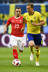 July 3, 2018 - Saint Petersburg, Russia - Ludwig Augustinsson of Sweden pictured with Xherdan Shaqiri of Switzerland during the 2018 FIFA World Cup Round of 16 match between Sweden and Switzerland at Sankt Petersburg Stadium in Sankt Petersburg, Russia on July 3, 2018  (Credit Image: © Andrew Surma/NurPhoto via ZUMA Press)