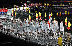 Guernsey's flag bearer Matthew Guille leads the team out during the Opening Ceremony for the 2018 Commonwealth Games at the Carrara Stadium in the Gold Coast, Australia.