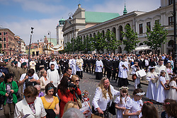 © Licensed to London News Pictures. 26/04/2016. Warsaw, Poland. Members of the Catholic Church and people taking part in a procession through Warsaw's Old Town in commemoration Corpus Christi (Boze Cialo). Corpus Christi (Body of Christ) is a Catholic feast celebrated as a national public holiday in Poland. It is the day when the Catholic Church commemorates the practice of Holy Eucharist, or Communion. Photo credit: Rob Arnold/LNP