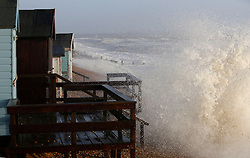 © Licensed to London News Pictures. 06/01/2014, Milford on Sea, UK. A wave batter the coast at Milford on Sea, England , Monday, Jan. 6, 2014. Part of UK continue to be affected by floods and strong wind. Photo credit : Sang Tan/LNP