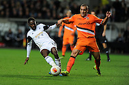 Swansea city's Nathan Dyer (l) is tackled by Valencia's Oriol Romeu. UEFA Europa league match, Swansea city v Valencia at the Liberty Stadium in Swansea on Thursday 28th November 2013. pic by Andrew Orchard, Andrew Orchard sports photography,