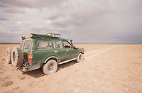 Storm clouds gather over the dusty expanse of Amboseli National Park, Kenya.