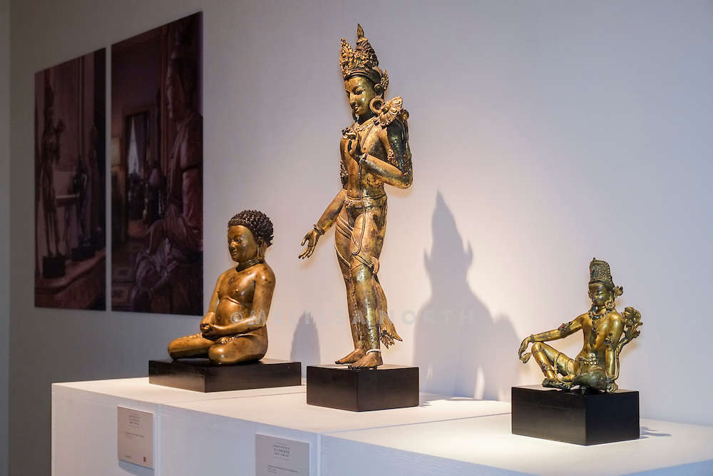 A Rare And Important Bronze Figure of a Mahasiddha, Gilt-Bronze Figure of Avalokiteshvara and Seated Figure of Indra, from the touring highlights of The Collection of Robert Hatfield Ellsworth, <br /> at Christies in King St, London, UK on Tuesday 16th December 2014. In celebration of this unparalleled collection of Asian Art, Christie's will host a series of auctions and online-only sales during New York Asian Art Week in March 2015. Photo by Melissa North. Ref B5690