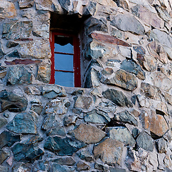 A window in the stone fire tower on Mount Prospect at at the John Wingate Weeks State Historic Site.  Lancaster, New Hampshire.