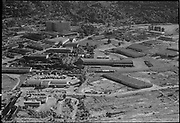 ackroyd_04539-3. aerial July 10, 1953 (area 26th & Yeon in foreground, looking toward Montgomery Ward. Esco in lower left, Pierce Freight Lines, Calbag junkyard, Nicolai). B F Goodrich on right, West Coast Fast Freight 2800 NW 25th Ave.)