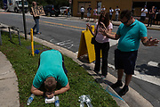 (From L) Jeremy Dubach, Gigi Greaves and Joe Greaves pray for victims near the crime scene at Pulse, the LGBTQ night club where a mass shooter killed 49 and injured 53 others, in Orlando, Florida, U.S.