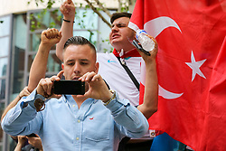 © Licensed to London News Pictures. 02/06/2019. London, UK. Danny Tommo (real name Daniel Thomas) an associate of Tommy Robinson takes a photograph of the protesters. <br /> Protesters take part in the annual Al Quds day protest and march from Home Office to Whitehall in central London. Al-Quds Day, an annual day of protest decreed in 1979 by the late Iranian ruler Ayatollah Khomeini, is celebrated to express support for the Palestinian people and their resistance against Israeli occupation. A counter demonstration by Israel supporters takes place. Photo credit: Dinendra Haria/LNP