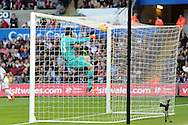 Petr Cech, the Arsenal goalkeeper jumps up to dislodge the ball that landed on the roof of the net. Barclays Premier league match, Swansea city v Arsenal  at the Liberty Stadium in Swansea, South Wales  on Saturday 31st October 2015.<br /> pic by  Andrew Orchard, Andrew Orchard sports photography.