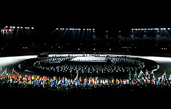 Athletes enter the stadium bearing flags during the Closing Ceremony for the 2018 Commonwealth Games at the Carrara Stadium in the Gold Coast, Australia.
